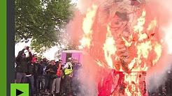 « Au bûcher ! » : une tête de Macron, une balle entre les yeux, brûlée à la manifestation du 22 mai